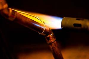 réparation de tuyau soudure chalumeau